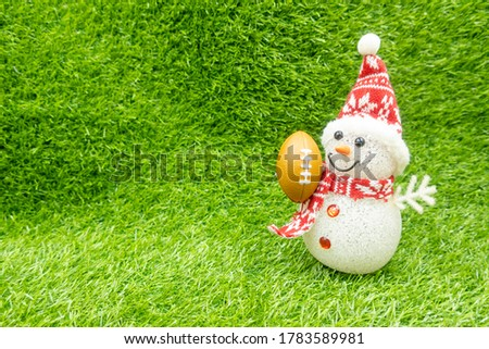 Snowman with American Football on green grass background for Soccer #1783589981