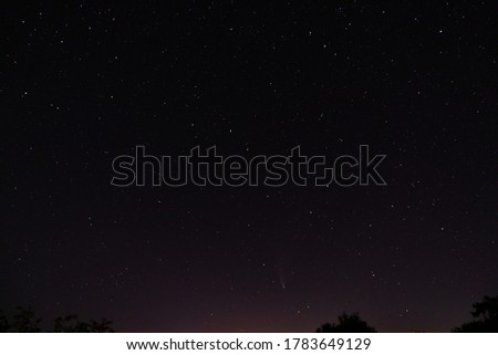 Comet Neowise in the black starry night sky. Night sky, space. The sky of the Northern hemisphere at night, various constellations, comets and cosmic celestial bodies. #1783649129