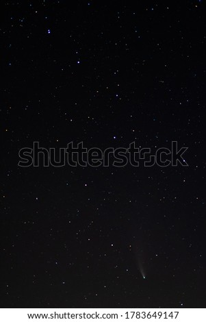 Comet Neowise in the black starry night sky. Night sky, space. The sky of the Northern hemisphere at night, various constellations, comets and cosmic celestial bodies. #1783649147