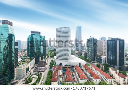 Aerial view of Shanghai's high density central business area. High rise office buildings and skyscrapers with glass surface. Urban roads with multiple lanes and green city park. Shanghai, China Royalty-Free Stock Photo #1783717571
