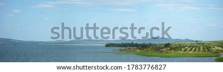 beautiful lake with hilly shores. sunny summer day. panoramic image of the lake shore. Lake Shira in Khakassia has mineral, slightly salted water. Lake water has healing properties.  #1783776827