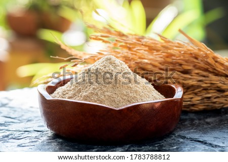 Rice bran and rice seeds on a natural background. #1783788812
