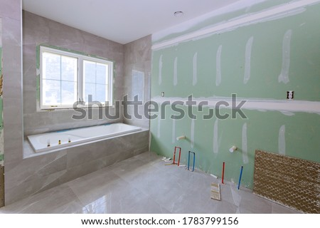 Under construction new bathtub remodeling a home bathroom, plumbing pipe system for new sinks #1783799156