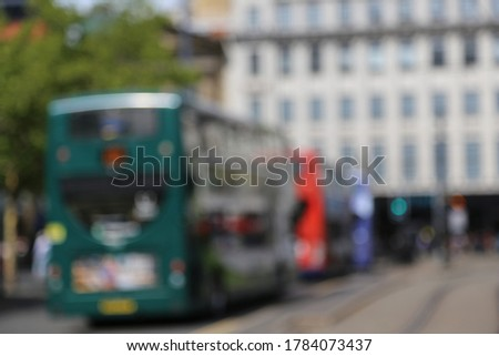 Abstract blurred in Manchester city with a buses queue against buildings. Manchester, UK. #1784073437