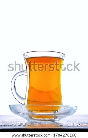 Low angle photo of cup with hot tea with copy space on white background #1784278160