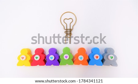 Light bulb symbol with human characters and hearts, isolated on white background. Business and Human Resource project management concept, successful teamwork brainstorming strategy in the organization