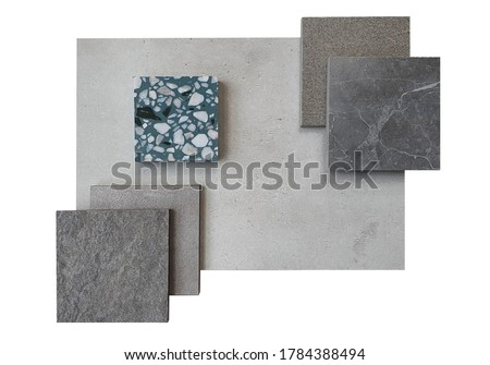 top view of interior material board contain concrete laminate ,stone tiles , grey marble tile and green terrazzo samples isolated on white background with clipping path. Royalty-Free Stock Photo #1784388494