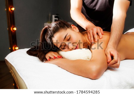 Massage is a beautiful photo. A beautiful woman lies in the massage therapist's office. Photos of spa treatments.