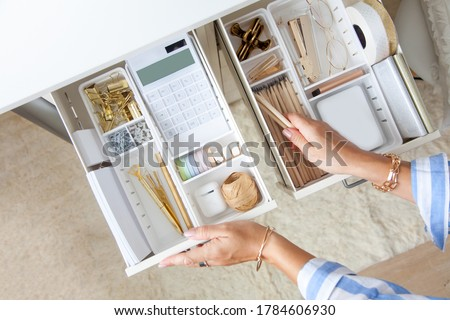 Female workplace. White work table. The stylish gold stationery is arranged very neatly in the drawers of the desk. Japanese storage method. #1784606930