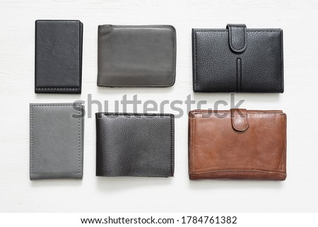 Wallets and card holder on the white background. Royalty-Free Stock Photo #1784761382
