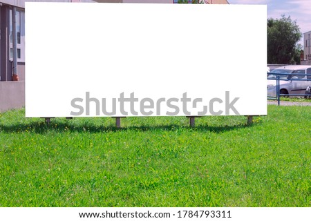 Advertising banner with white space for text on the background of city streets. Against the backdrop of city streets and green lawns
