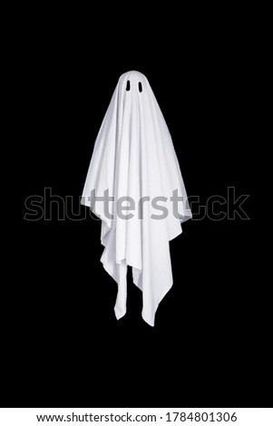 White ghost with black eyes, made from a bedsheet. Isolated on black background. Royalty-Free Stock Photo #1784801306
