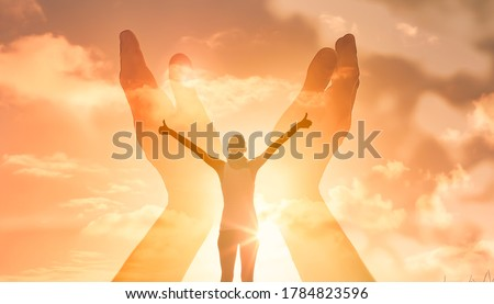 Young woman feeling good and inspired. Freedom a spirituality concept.  Royalty-Free Stock Photo #1784823596