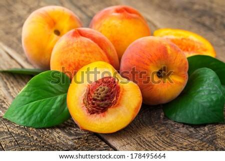 fresh peaches on wood background #178495664