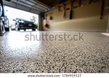 Epoxy floor in home garage Royalty-Free Stock Photo #1784959127