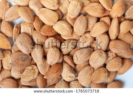 Background full of peeled apricot kernels Royalty-Free Stock Photo #1785073718