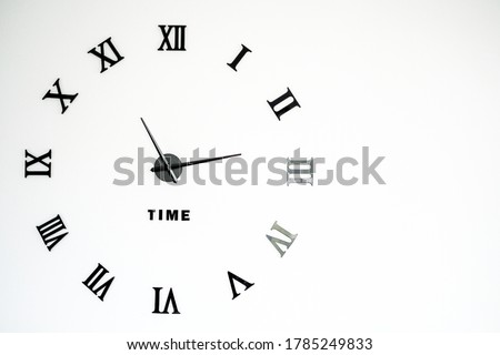 Clock icon faces with parts design with shiny with blurred from right of picture : Elegant wall clock with vintage hour hand for time isolated on white background. Roman numeral clock