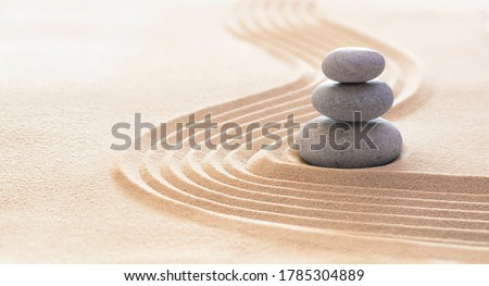 Zen Stones With Lines On Sand - Spa Therapy - Purity harmony And Balance Concept  Royalty-Free Stock Photo #1785304889