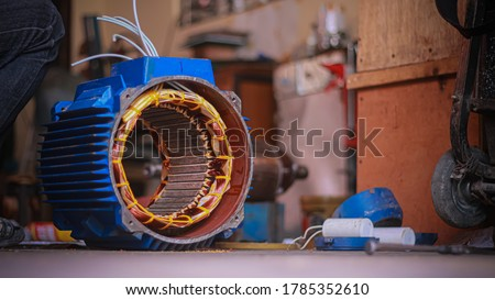 Repair 3-phase motors of industrial plants. Royalty-Free Stock Photo #1785352610