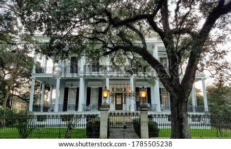 Garden district new orleans mansion  Royalty-Free Stock Photo #1785505238