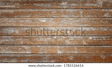 Full frame image of the old rustic wooden planks with shabby peeling paint. Colorful  brown vignetted texture or background (16:9 format) for design, copy space