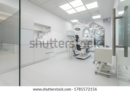 Interior of white modern dentistry medical room with special equipment Royalty-Free Stock Photo #1785572156