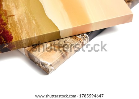 Canvas prints isolated on white background. Wrapped canvases, edge, corner, closeup. Detail of stretched photography with gallery wrapping. Photo printed on canvas Royalty-Free Stock Photo #1785594647
