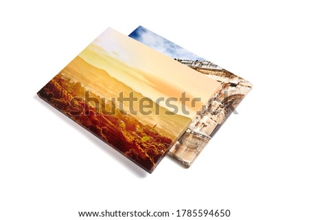 Canvas prints isolated on white background. Two stretched canvases with gallery wrap. Summer sunset pic, landscape photography. Photo printed on canvas, perspective view