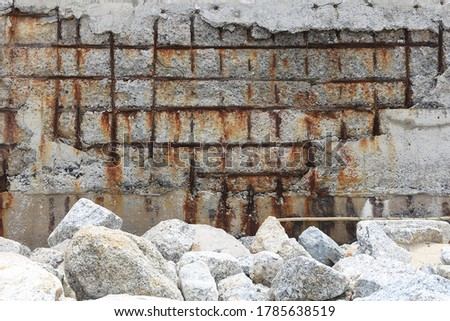 Steel corrosion in reinforced concrete. Reinforced concrete with damaged and rusty steel bar in marine and other chloride environments. Degraded concrete and corrosion of reinforcement bars Royalty-Free Stock Photo #1785638519