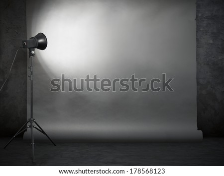 photo studio in old grunge room with concrete wall and paper background  #178568123