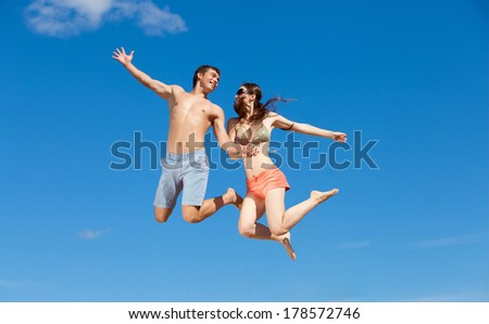 Portrait of a happy young couple enjoying at beach #178572746