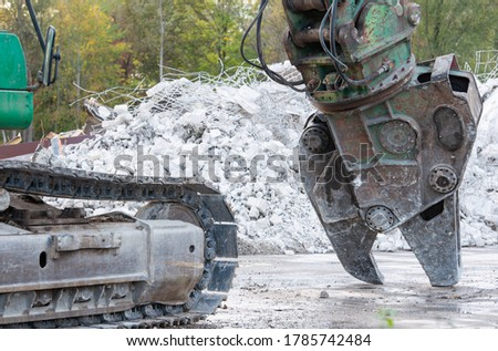 Building demolition with a demolition excavator on a building site Royalty-Free Stock Photo #1785742484