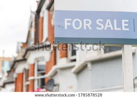 For Sale signs displayed outside terraced houses in Harringay Ladder, London