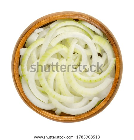 Sliced fresh white onions in wooden bowl. Onions cut into rings. A cultivar of dry onion,  Allium cepa, with white skin and flesh. Closeup, from above, on white background, isolated, macro food photo. #1785908513