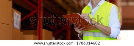 work man checking inventory in stock room on clip board chart, quality controller, panorama banner size, warehouse factory concept.