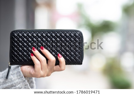 woman person holding a wallet in the hand. Cost control expenses shopping in concept. Leave space to write descriptive text. Royalty-Free Stock Photo #1786019471