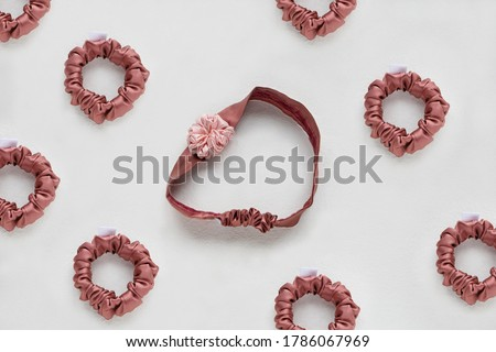 Coral-Pink hair accessories with textile rose. silk Pink Scrunchy isolated on white backdrop. Flat lay Hairdressing tools and accessories for woman - Colorful Hair Scrunchies, Elastic HairBands