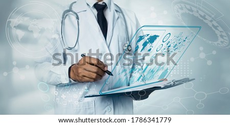 Double exposure of healthcare And Medicine concept. Doctor hand touching on modern virtual screen interface,  Background toned image blurred.