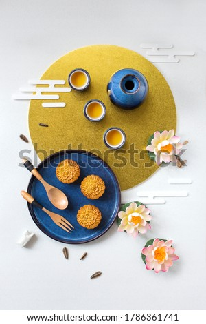 Flat lay Mid autumn festival snack and drink moon cake on moody black textured  background still life image.  #1786361741