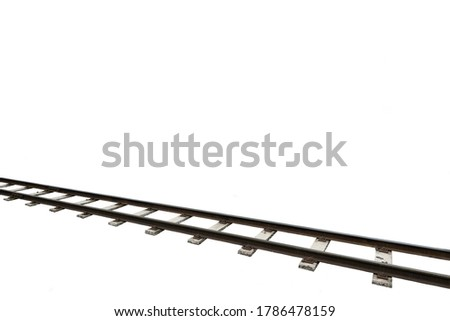 Railway tracks running diagonally through the picture over white background