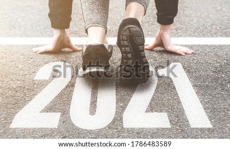 Sneakers close-up, finish 2020. Start to new year 2021 plans, goals, objectives Royalty-Free Stock Photo #1786483589