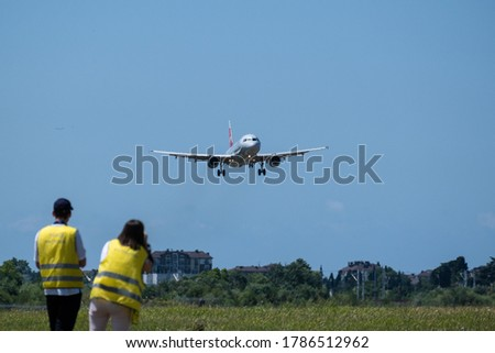 plane spotting at the airport of Sochi. A lot of people take photos of the plane. Hobby to watch the planes. Photographers airplane