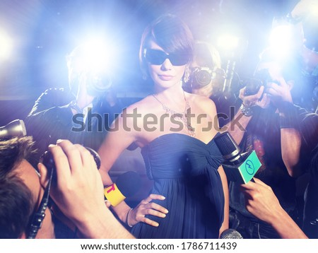 Glamourous Woman Surrounded by Paparazzi Royalty-Free Stock Photo #1786711439