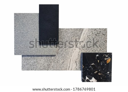 top view of interior material samples contains grey emperado tile ,grey concrete tile ,black terrazzo and black quartz sample isolated on white background with clipping path. Royalty-Free Stock Photo #1786769801