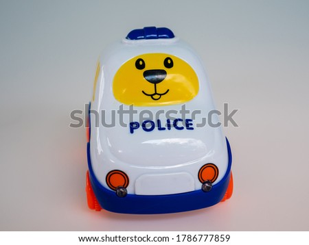 Cartoon police car toy isolated white background.