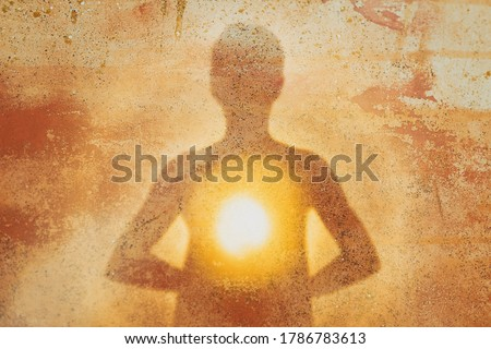 Female silhouette radiating light from within a spiritual heart opening. Royalty-Free Stock Photo #1786783613