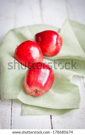 Fresh farm raised apples on rustic wooden background #178680674