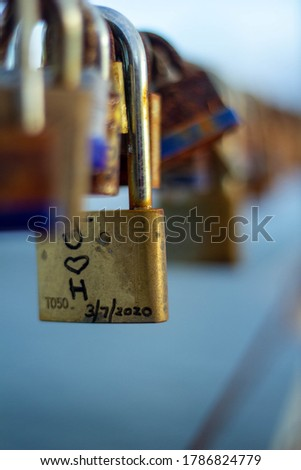 Padlocks that symbolize union and love forever on the pink dock of Catano, Puerto Rico.