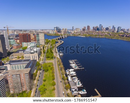 Aerial view of Cambridge on the left and Boston on the right connected by Longfellow Bridge from Charles River, Cambridge, Massachusetts MA, USA.