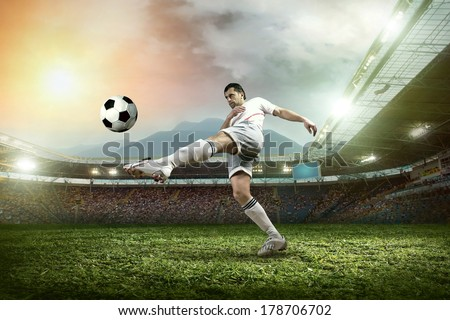 Soccer player with ball in action at stadium. #178706702